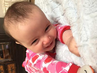 My refluxer doing tummy time at five months...and she's happy!